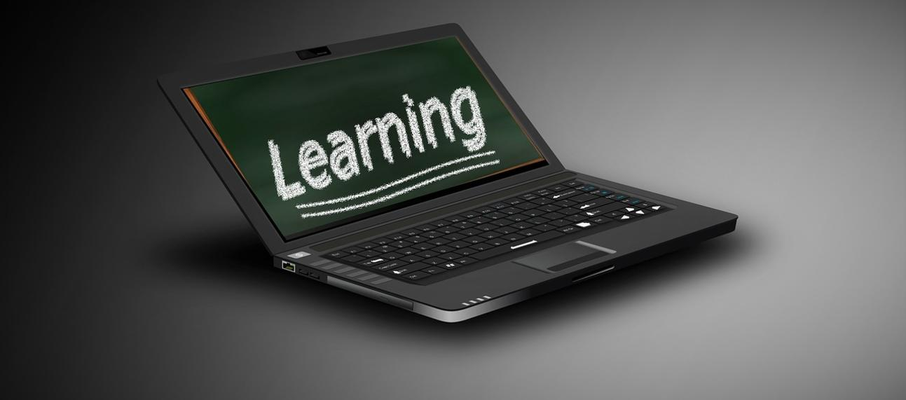 'Learning' written on a laptop monitor