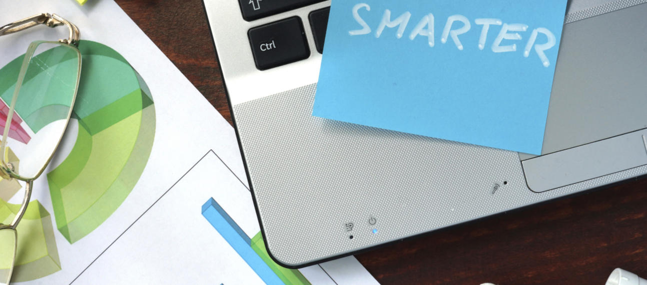 Sticky note on a laptop saying  'work smarter'