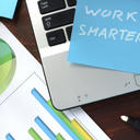 Sticky note on a laptop saying  'work smarter'