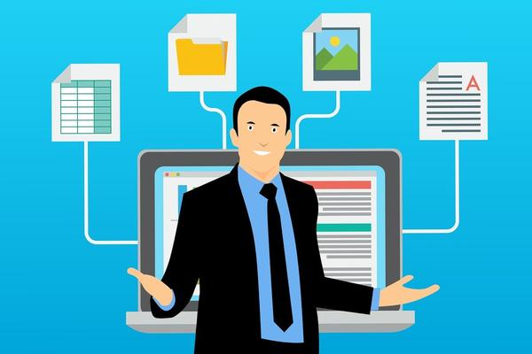Cartoon image of a person in front of a monitor with four different types of data (spreadsheet, image, docs etc) feeding in.
