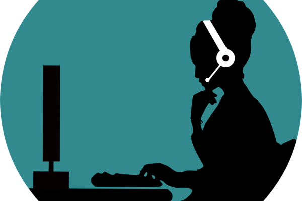 Cartoon image of a silhouette person wearing a headset and looking a monitor