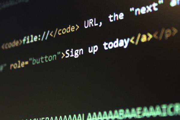 'sign up today' shown in html code on a black screen