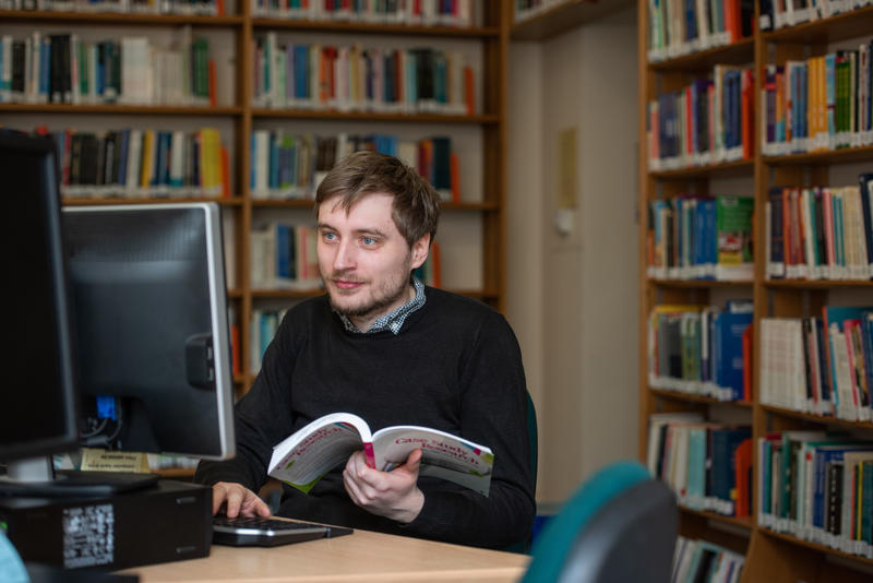 Researcher at a computer in the library