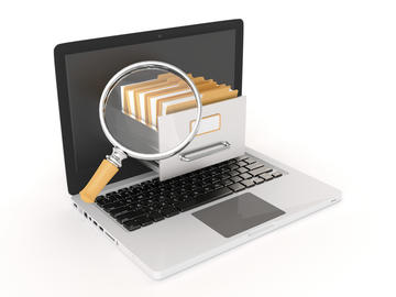 Cartoon image of a laptop with a filing drawer emerging from it