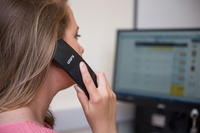 person using telephone